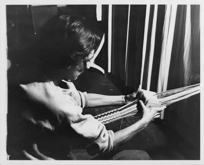 Anni Albers, Photograph of Anni Albers card weaving at Black Mountain College. Anni Albers taught Weaving and Textile Design at Black Mountain College from 1933-1949. Courtesy The North Carolina State Archives