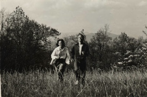 """Hand and hand through the fields [Craggy Mtns., NC]."" Publicity photo for Black Mountain College featuring two BMC college students. Left to right: Betty Kelley, Leonard Billing. Courtesy the North Carolina State Archive"