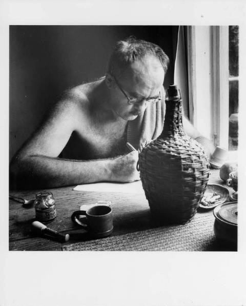 Charles Olson writing at Black Mountain College. Portrait taken by Jonathan Williams of Charles Olson writing at Black Mountain College. Charles Olson taught Writing and Literature at Black Mountain College 1948-1949, 1951, 1953-1956 and in 1953 was appointed the college's Rector.