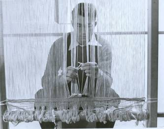 Student Don Page at a loom, doing work for a Black Mountain College weaving class. Courtesy of Western Regional Archives.