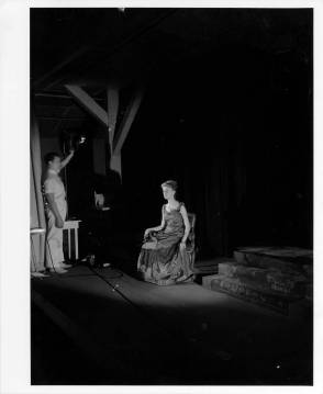 """Jane Robinson on stage with stage director George Randall (at left), getting ready for a performance of """"The Cherry Orchard"""" by Anton Chekhov at Black Mountain College, Spring 1941. Courtesy of Western Regional Archives."""