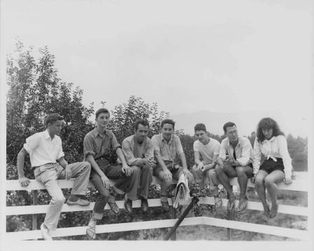 """Group photo taken at the entrance to the Studies Building (?), Lake Eden Campus, Black Mountain College, Summer 1946. From left to right: Kendall Cox, Theodore """"Quintus"""" Dreier, Jr., Bob Murphy, Peter Oberlander, unidentified person, Nick Muzenic, and Barbara Stein. Courtesy of Western Regional Archives."""