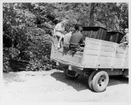 Moving the pianos to the Lake Eden campus from the Blue Ridge campus. Left to right: Jane Robinson, Paul Wiggin, George Cadmus, and unidentified person. Courtesy of Western Regional Archives.