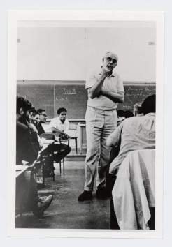 Charles Olson in a classroom, among students. Reproduced courtesy of The Charles Olson Research Collection, Archives and Special Collections at the Thomas J. Dodd Research Center, University of Connecticut Libraries.