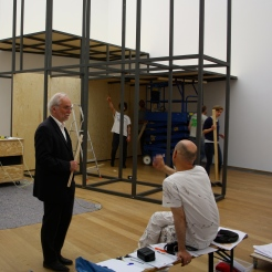 "Museum director, Eugen Blume, at the construction site of ""Black Mountain - an interdisciplinary experiment 1933-1957"" at Hamburger Bahnhof - Museum für Gegenwart Berlin. The exhibition's architecture has been designed by raumlaborberlin."