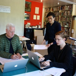 "Arnold Dreyblatt, Anna Schapiro, Project Coordinator, and Anne Steinhagen working on ""Performing the Black Mountain Archive"" at Dreyblatt's studio in Berlin ."