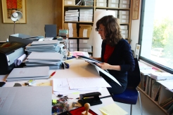 "Ofri Lapid working on ""Performing the Black Mountain Archive"" at Arnold Dreyblatt's studio in Berlin."