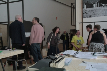 """Visit by the President of the Muthesius Kunsthochschule Kiel, Dr. Zerbst, at """"PERFORMING the Black Mountain ARCHIVE"""" with the participating students of the Muthesius Kunsthochschule Kiel at the Black Mountain exhibition at Hamburger Bahnhof - Museum für Gegenwart - Berlin. Courtesy: Anne Steinhagen"""
