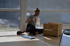 Photo by Elizabet Damyanova. Johanna Dahlbäck arranging the inside of a box.