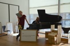 Photo by Elizabet Damyanova. Tobias Shaw Petersen reading while Desiree Vaksdal plays the piano.