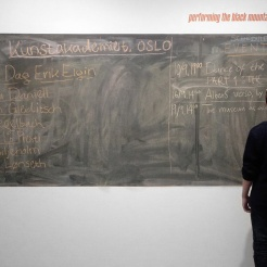 First day at the museum, Michael Lo Presti writing down scheduled events at the blackboard by the entrance.